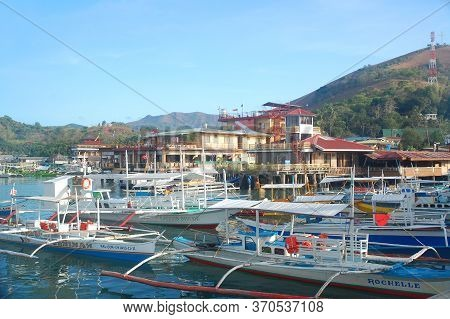 Palawan, Ph - March 7 - Passenger Wooden Boats Dock At Coron Public Market On March 7, 2012 In Coron