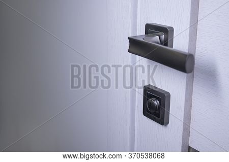 Door Handle In The Interior. Knob Close-up Elements. Light Wooden Doors In In Modern Style In The In