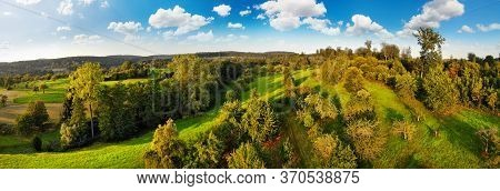 Aerial Panorama Of Beautiful Rural Landscape, A Mix Of Green Meadows And Groups Of Trees On Hills, W