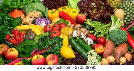 Arranged Pile Of Fruits And Vegetables In Many Appetizing Colors, Inviting To Lead A Healthy Plant-b