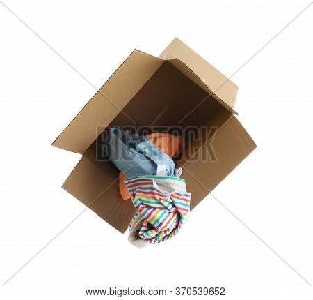 Overturned Cardboard Box With Clothes Isolated On White