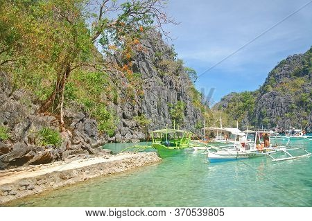 Palawan, Ph - March 7 - Kayangan Lake Limestone Rock Formation And Boats On March 7, 2012 In Coron,