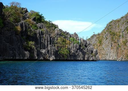 Limestone Rock Formation And Turquoise Water Sea In Coron, Palawan