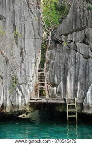 Twin Lagoon Water, Ladder And Limestone Rock Formation In Coron, Philippines