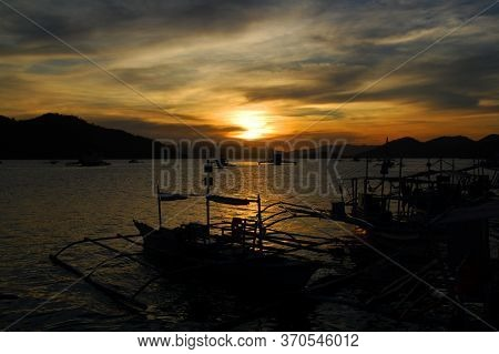 Sunset Scenery With Mountain, Sea, And Boats Silhouette In Coron, Palawan, Philippines.
