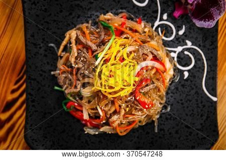 Top View On Appetizing Korean Salad Funchoza With Beef Starch Noodles And Vegetables, Horizontal