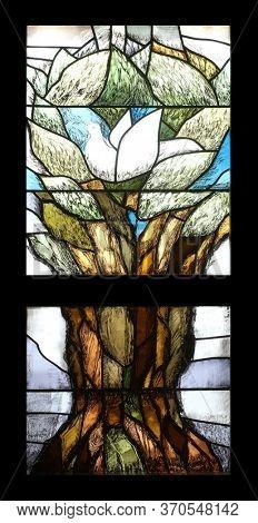 OBERSTAUFEN, GERMANY - OCTOBER 19, 2014: Noah's dove, Hope, stained glass window by Sieger Koder in Chapel in Oberstaufen, Germany