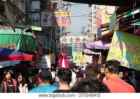 Nantou, Taiwan - Jan 9th, 2020: people walk and shopping in the traditional market at Puli town, Nantou, Taiwan