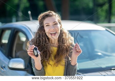 Cute Young Woman Holding The Keys From A New Car And Feeling Awesome
