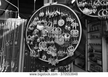 Handmade Earrings Hanging For Sale For Tourists At The Street Market In Udaipur India. Colorful Hand