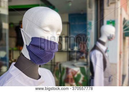 Mannequins in showcase of shop wearing masks against coronavirus during Covid-19 pandemic in Italy