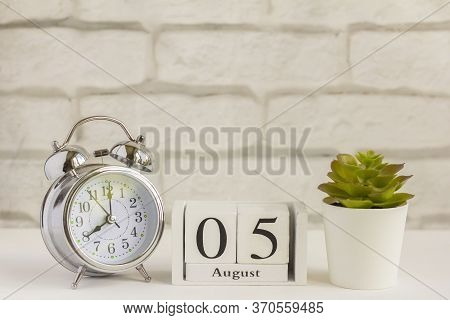 August 5 On A Wooden Calendar Next To The Alarm Clock. Summer Day, Empty Space For Text.calendar For