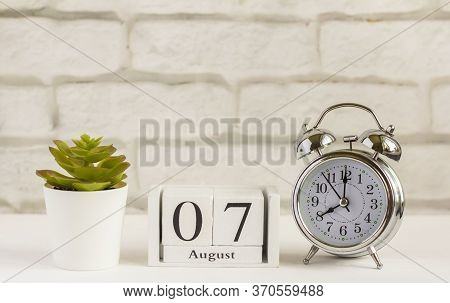 August 7 On A Wooden Calendar Next To The Alarm Clock. Summer Day, Empty Space For Text.calendar For