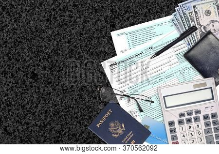 Irs Form 1040 Individual Income Tax Return Lies On Flat Lay Office Table And Ready To Fill. U.s. Int