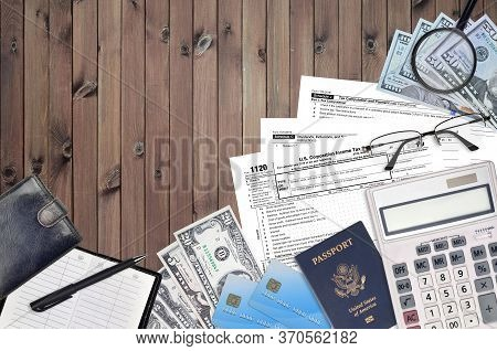 Irs Form 1120 U.s. Corporation Income Tax Return Lies On Flat Lay Office Table And Ready To Fill. U.
