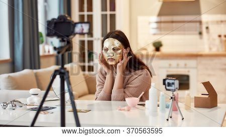 Female Blogger Recording A Tutorial Video For Her Beauty Blog About Skincare Routine. Vlogger Testin