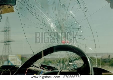 Broken Car Windshield. Web Of Radial Cracks, Crack On Triple Windshield. Broken Windshield Car, Dama