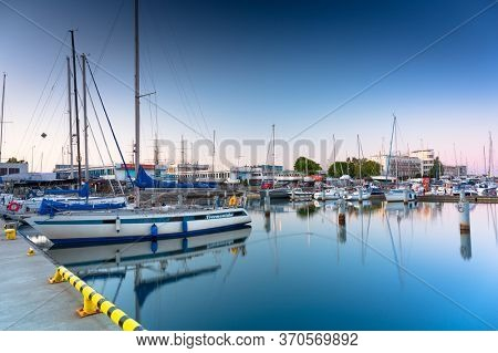 Gdynia, Poland - June 3, 2020: Beautiful sunset over the marina at Baltic Sea with yachts in Gdynia, Poland.