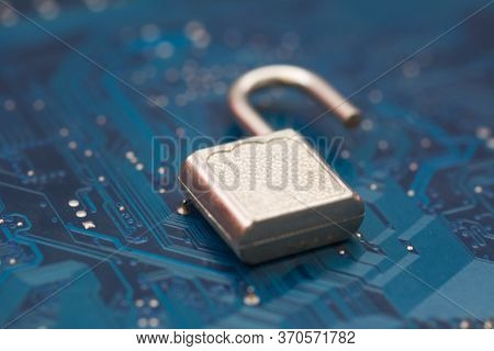 Opened Security Lock, Open Padlock On Background Blue Computer Printed Circuit Board. Cyber Security