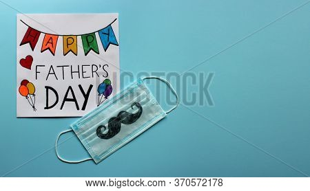 Greeting Card Happy Father's Day And Protective Face Mask With A Mustache Drawn By A Child As A Gift