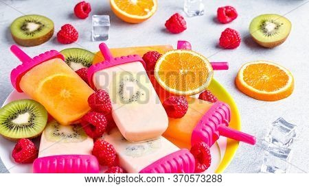 Summer Refreshing Homemade Popsicles With Oranges And Kiwi. Healthy Snack With Fruits And Frozen Jui