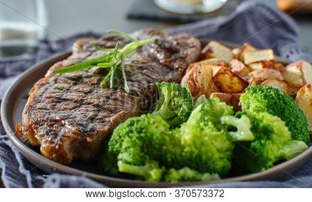grilled new york strip steak with rosemary and vegetables