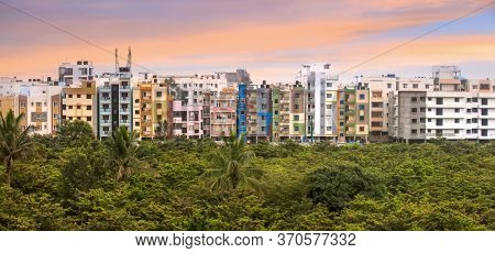 Bangalore, Karnataka, India - December,12, 2015: Colorful homes built with plaster in suburban Bangalore city in the morning time