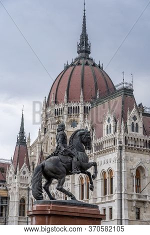 Budapest, Hungary - Feb 8, 2020: Parliament Dome View With Equestrian Statue In Kossuth Square