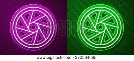 Glowing Neon Line Camera Shutter Icon Isolated On Purple And Green Background. Vector Illustration