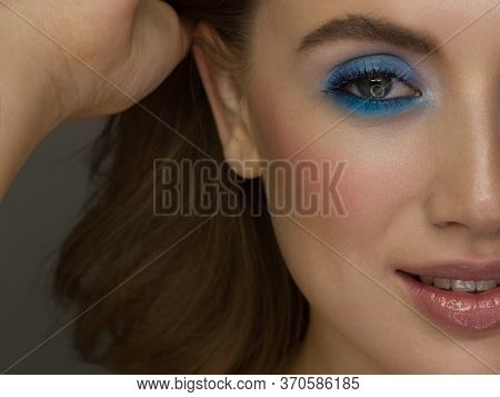 Half A Beauty Portrait With Beautiful Fashionable Evening Make-up, Black Jiggles On Eyes And Extreme