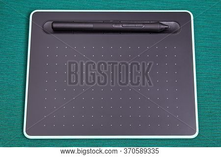 A Graphic Tablet With A Wireless Pen Or Stylus Is An Input Device For Drawing On A Computer Screen.