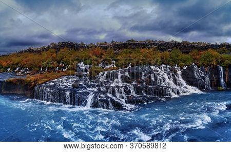 Hraunfossar Waterfall. Lava Waterfalls. Waterfall Flowing Down From The Lava Fields On The Canyon Of
