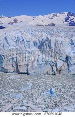 Icy Waters And Icy Mountains In A Glacial Landscape Of The Perito Moreno Glacier In Los Glaciares Na