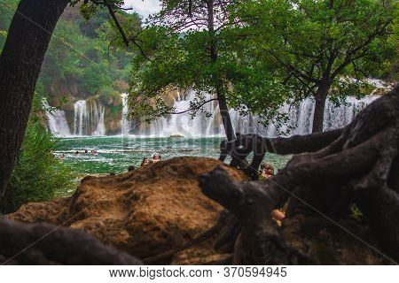 Krka National Park, Croatia - July 27 2018: Wild Landscape And Waterfall At Famous Tourist Attractio