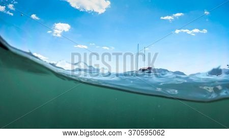 Underwater Image Of Yacht On The Sea Surface