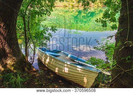 Abandoned Boat At The Riverside At Krka National Park In Croatia