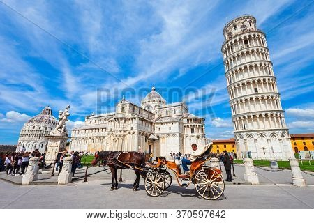Pisa, Italy - April 06, 2019: Pisa Leaning Tower, Pisa Cathedral And Baptistery At Piazza Dei Miraco