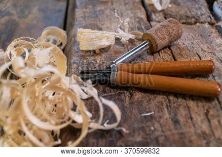 Joiner Tools On An Old Workbench. Traces Of Wood Processing. Workplace Of A Wood Craftsman.