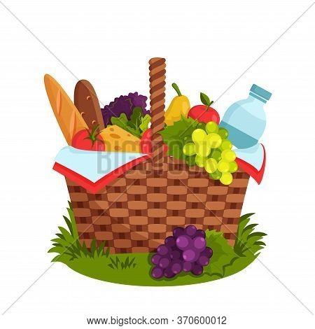 Wicker Picnic Basket Full Of Healthy Food. Picnic Basket On Grass. Bottle Of Water, Apple, Pear, Che