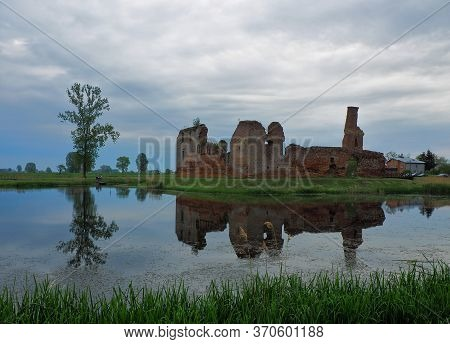 Ruins Behind The Moat.  Besiekiery, Poland - May 10, 2020 Surrounded By Water, The Ruins Of A Mediev