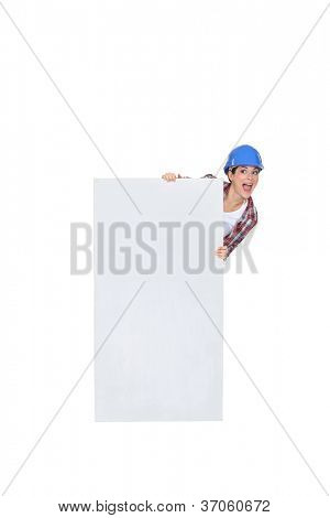 Chirpy female poster stood with blank panel