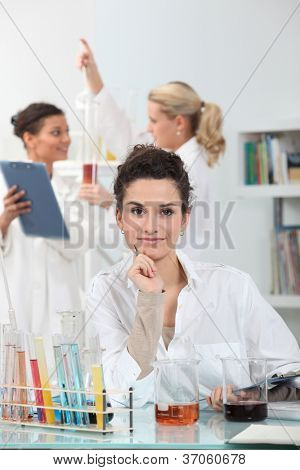 Young women conducting experiments