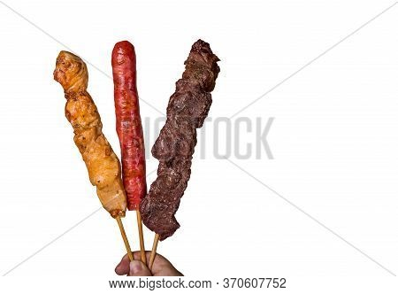 Assorted Steak Skewers On White Background. Assorted Steak Skewers On White Background. \nin Brazil