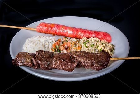 Assorted Skewers On Black Background. In Brazil Is Called Espetinho