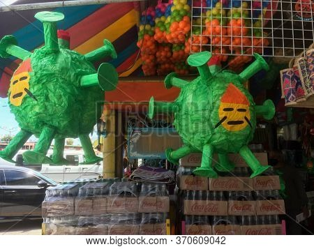 Coronavirus Pinatas Hanging In A Mexican Market. Covid 19 In Mexico. Racism And Racist Imagery In 20