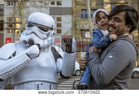 Tehran, Iran - 2019-04-03 - Child Is Frightened When Father Hands Him To Star Wars Storm Trooper Cha