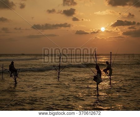 Galle, Sri Lanka - 2019-04-01 - Stilt Fishermen Of Sri Lanka Spend All Day On Small Platforms To Cat