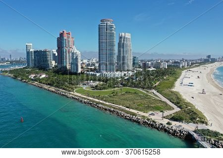 Aerial View Of South Pointe Park And South Beach In Miami Beach, Florida With Port Miami And City Of