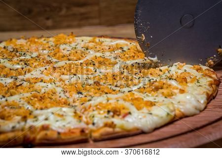Cutting The Chicken Pizza With Catupiry Cheese, In Brazil It Is Called Chicken Pizza With Catupiry C