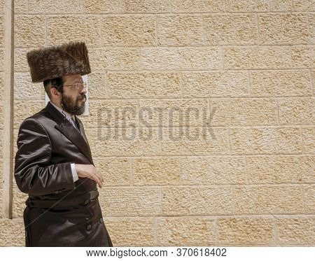 Jerusalem, Israel - 2019-04-26 - Orthodox Jew Walks In Front Of Wall.
